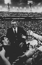 Vince Lombardi is carried off the field after leading the Packers to victory.