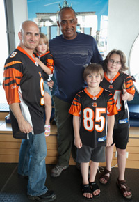 Marvin Lewis poses for a photo with a family of Bengals fans at the USO Center in the Ramstein Passenger Terminal at Ramstein Air Base in Germany.