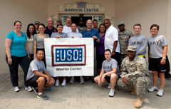 USO Warrior Center staff poses with four NFL coaches during a tour stop at Ladsthul Regional Medical Center in Germany.
