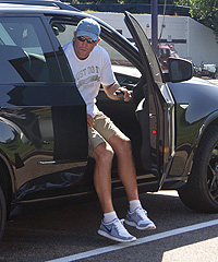 Vikings QB Brett Favre (above) exits Ryan Longwell's SUV after arriving at team headquarters Tuesday.