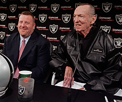 Raiders coach Al Davis (right), shown alongside Tom Cable during happier times, said Tuesday that the former coach brought problems to the team.