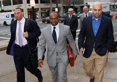 NFL Players Association executive director DeMaurice Smith (center) arrives for Friday's meeting with NFL officials and a federal mediator.