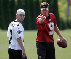 Country-music star Kenny Chesney (left) has many fans among NFL players, including Saints QB Drew Brees.