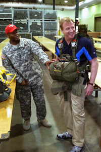 NFL Commissioner Roger Goodell (right) shares a laugh with troops Friday while visiting Fort Bragg in North Carolina.