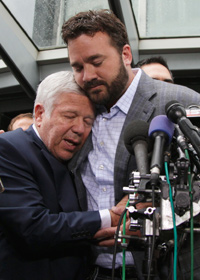 Colts center Jeff Saturday (right) honors Patriots owner Robert Kraft for his sacrifice and devotion in working toward a labor deal.