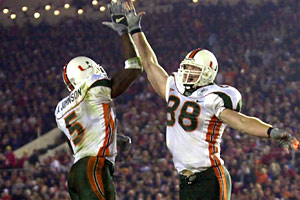 Andre Johnson (5) celebrates a touchdown with Jeremy Shockey during the 2002 Rose Bowl. Johnson, now with the Texans, has denied alleged ties to booster Nevin Shapiro. Shockey, now with the Panthers, wasn't implicated in the Yahoo! report.