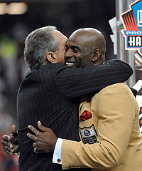 Deion Sanders is congratulated by Falcons owner Arthur Blank at his Hall of Fame induction.