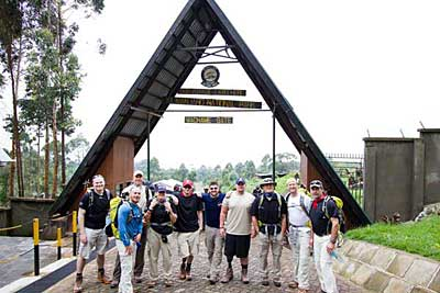 Team Hard Target gathers for a group photo at Machame Gate as it enters Kilimanjaro National Park.