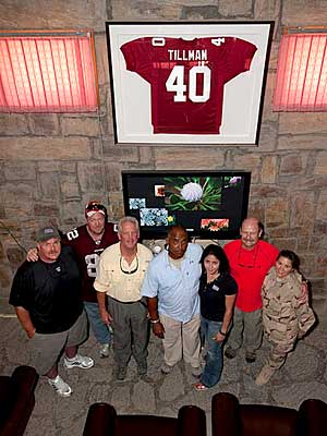 Andy Reid, John Fox, Marvin Lewis and Brad Childress visit the Pat Tillman USO Center at Bagram Air Base in 2010.