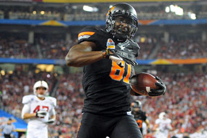 Justin Blackmon had eight catches for 186 yards and three TDs in the Fiesta Bowl.