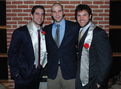 Aaron Rodgers (left) and Graham Harrell (right) pose with TKE brother Dan Zegers.