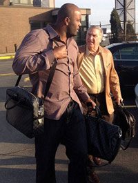Mario Williams (left) walks with Bills GM Buddy Nix.