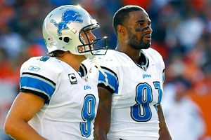 Matthew Stafford (left) and Calvin Johnson make sweet music on the gridiron, but how well would they represent District 8 in The Hunger Games?