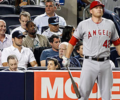 Jets QB Tim Tebow (left) takes in Sunday night's Yankees-Angels game at Yankee Stadium in New York.