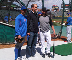 Denver Broncos QB Peyton Manning poses for a photograph with New York Mets pitcher R.A. Dickey (left) and Colorado Rockies first baseman Todd Helton (right).