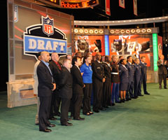 Military service members are recognized on-stage during the NFL Draft at Radio City Music Hall.