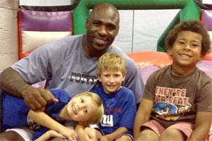 Brandon Jacobs and his son, Brayden, treated young Giants fan Joe Armento and his brother, Nick, to a day out and other goodies.