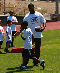 Giants LB Keith Rivers (above) works with kids at teammate Terrell Thomas' football camp Saturday in Rancho Cucamonga, Calif.