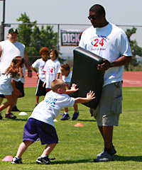 Broncos LT Ryan Clady (above) worked with kids at Giants CB Terrell Thomas' youth football camp Saturday in Rancho Cucamonga, Calif.