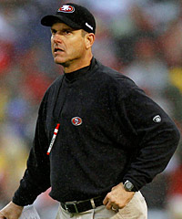 Is 49ers coach Jim Harbaugh (above) a little crazy? One of his players, CB Carlos Rogers, believes so.