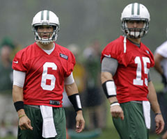Mark Sanchez (left) will have Tim Tebow -- not to mention Jets fans -- breathing down his neck all season. (Julio Cortez/Associated Press)