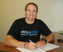 Drew Brees had plenty of reasons to smile after signing his five-year, $100 million contract with the New Orleans Saints on Sunday. (Alex Restrepo/New Orleans Saints)