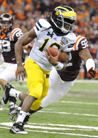 Denard Robinson excels at quarterback for Michigan, but he might project as more of a hybrid playmaker in the NFL.