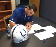 Indianapolis Colts owner Jim Irsay tweeted this photo of No. 1 overall draft pick Andrew Luck signing his four-year, $22.1 million contract Thursday.