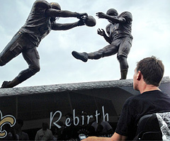 The Saints tweeted this photo of Steve Gleason, stricken with ALS, admiring a statue erected in his honor outside the Mercedes-Benz Superdome. (New Orleans Saints)