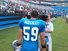 Carolina Panthers rookie LB Luke Kuechly does some rookie chores, all with his name misspelled on his jersey.
