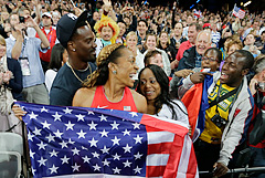 Jacksonville Jaguars CB Aaron Ross (left) and wife Sanya Richards-Ross celebrate her gold medal-winning run in the 400 meters Sunday at the London Olympics.