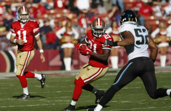 Frank Gore and the 49ers could still factor into the race. Photo: Paul Sakuma