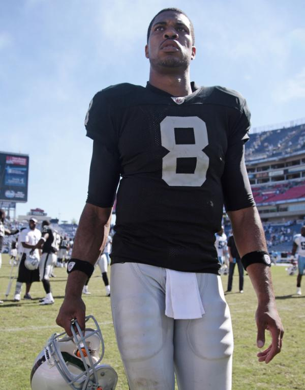 Oakland Raiders quarterback Jason Campbell walks off the field following a 38-13 loss to the Tennessee Titans in their NFL football game at LP Field in Nashville, Tenn., Sunday, Sept. 12, 2010. (AP Photo/Dave Martin)