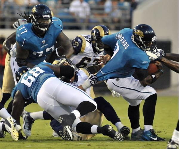 David Garrard swarmed by a sea of Rams. Photo by Stephen Morton/AP.