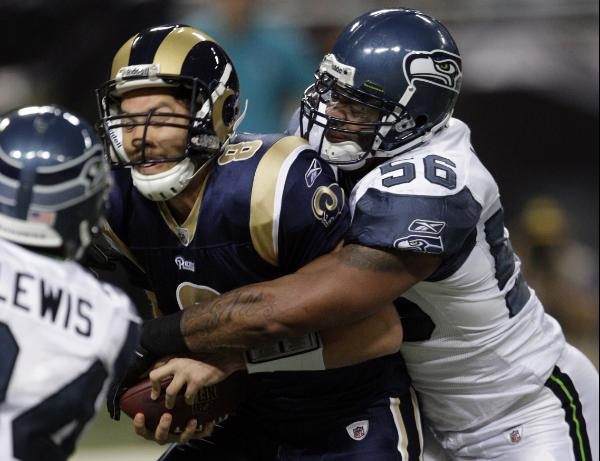Sam Bradford sacked. AP Photo/Tom Gannam
