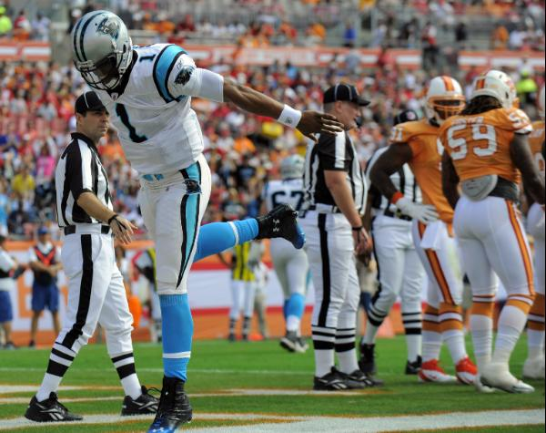 Cam Newton celebrates. AP Photo/Brian Blanco