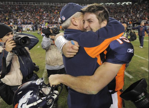 Tim Tebow and John Fox celebrate. AP Photo/Jack Dempsey