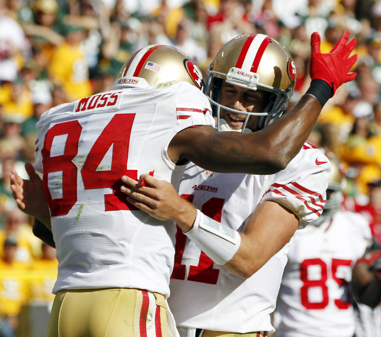 The San Francisco 49ers' Randy Moss is congratulated by quarterback Alex Smith after Moss caught a touchdown pass. (AP Photo/Mike Roemer)