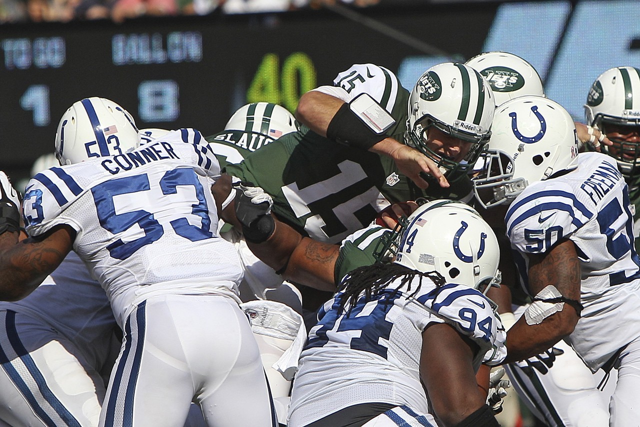 New York Jets quarterback Tim Tebow dives for extra yards against the Indianapolis Colts. (AP Photo/Seth Wenig)