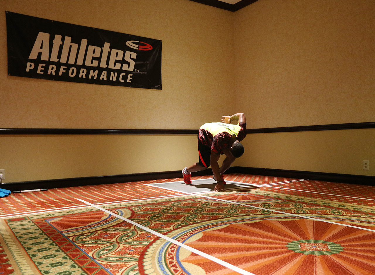 For players running the 40-yard dash at the combine, it's most important to explode off the line. Athletes' Performance has players practice their starts in the ballroom but combats the slick carpet by using duct tape and adhesive spray at the line so no one slips.
