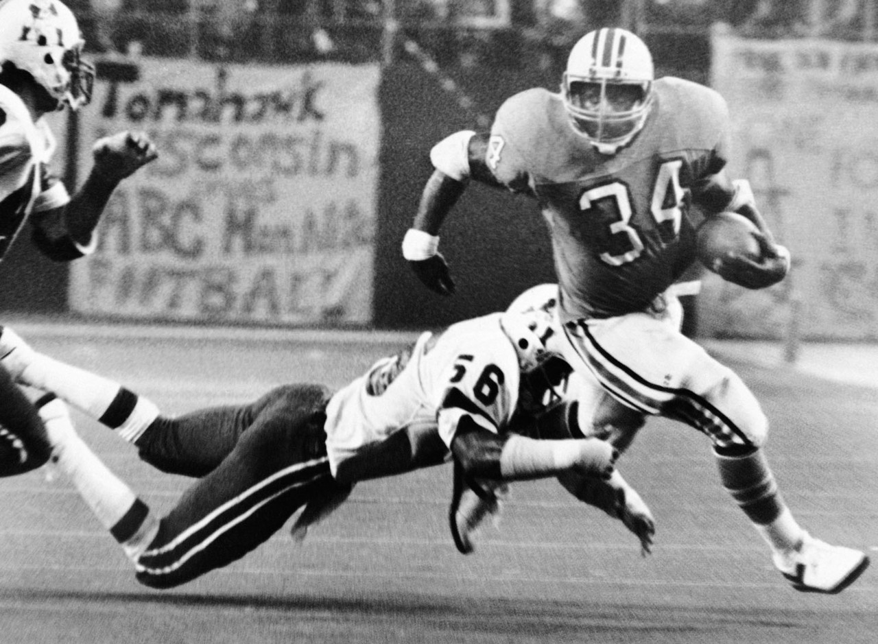 In 1980, Earl Campbell arguably had his greatest season as a professional, rushing for 1,934 yards in only 15 games. Most impressive about that season are his four 200-yard rushing performances, the most by a player in a single season in NFL history, including back-to-back 200-yard games in Week 7 and Week 8. The 1980 season was the third consecutive year in which Campbell led the league in rushing, tied for the league's second longest such streak, behind only Jim Brown's five straight seasons from 1957 to 1961.
