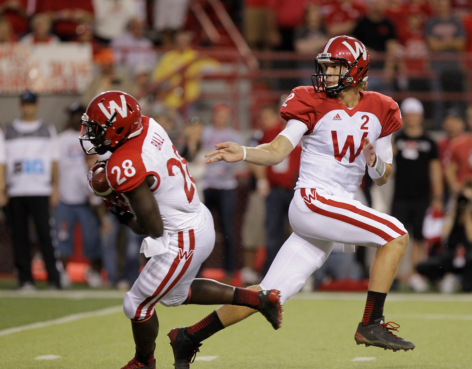 Wisconsin quarterback Joel Stave, right, hands off the ball to Montee Ball during an NCAA college football game between Nebraska and Wisconsin, in Lincoln, Neb., Saturday, Sept. 29, 2012. Nebraska ran four straight scoring drives against a tiring Wisconsin defense in the second half to lead No. 22 Nebraska's comeback from a 17-point deficit to defeat the Badgers 30-27. (AP Photo/Nati Harnik)