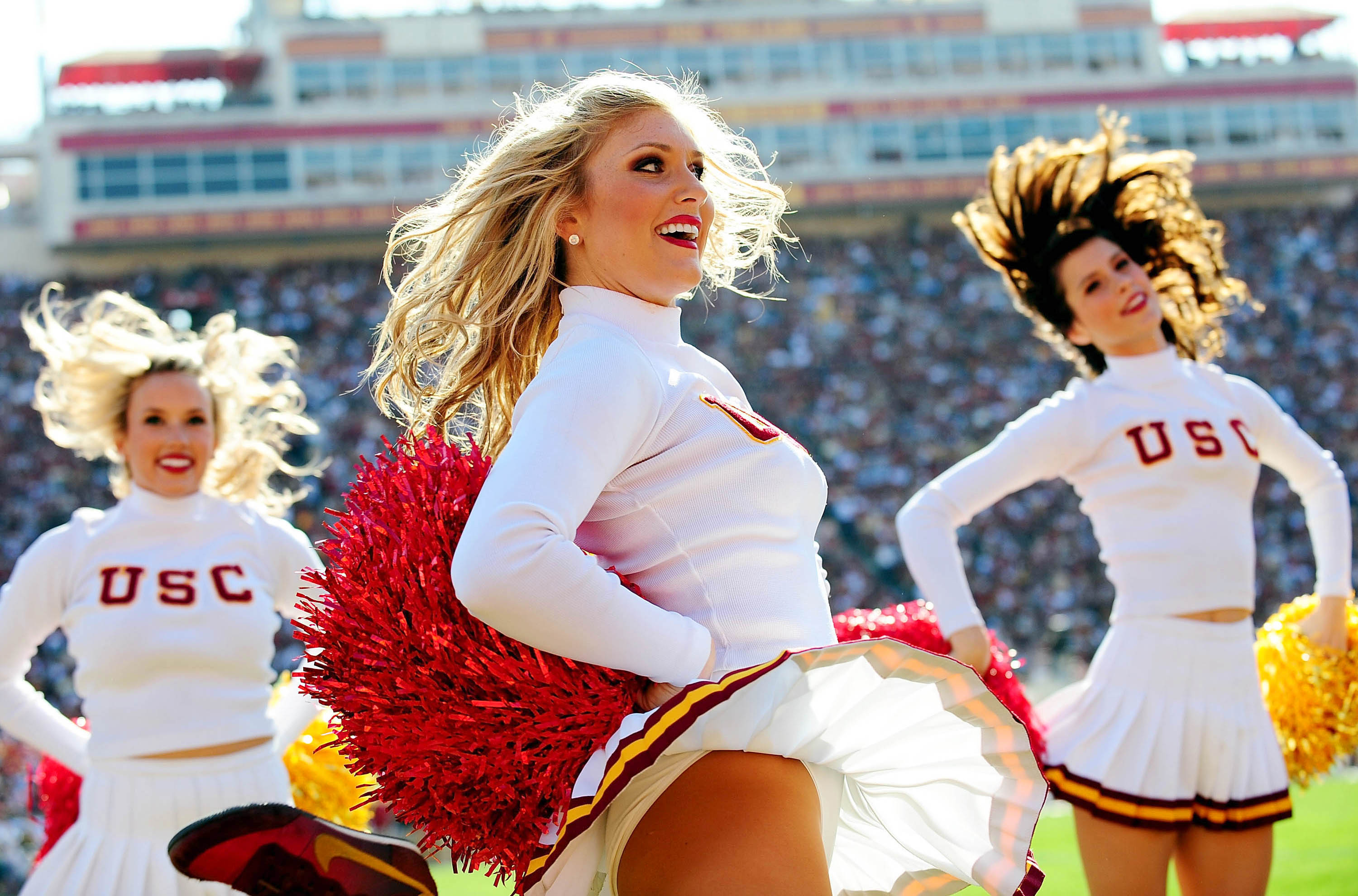 Southern California Trojans cheerleaders perform during the first half at the Los Angeles Memorial Coliseum. Mandatory Credit: Gary A. Vasquez-USA TODAY Sports