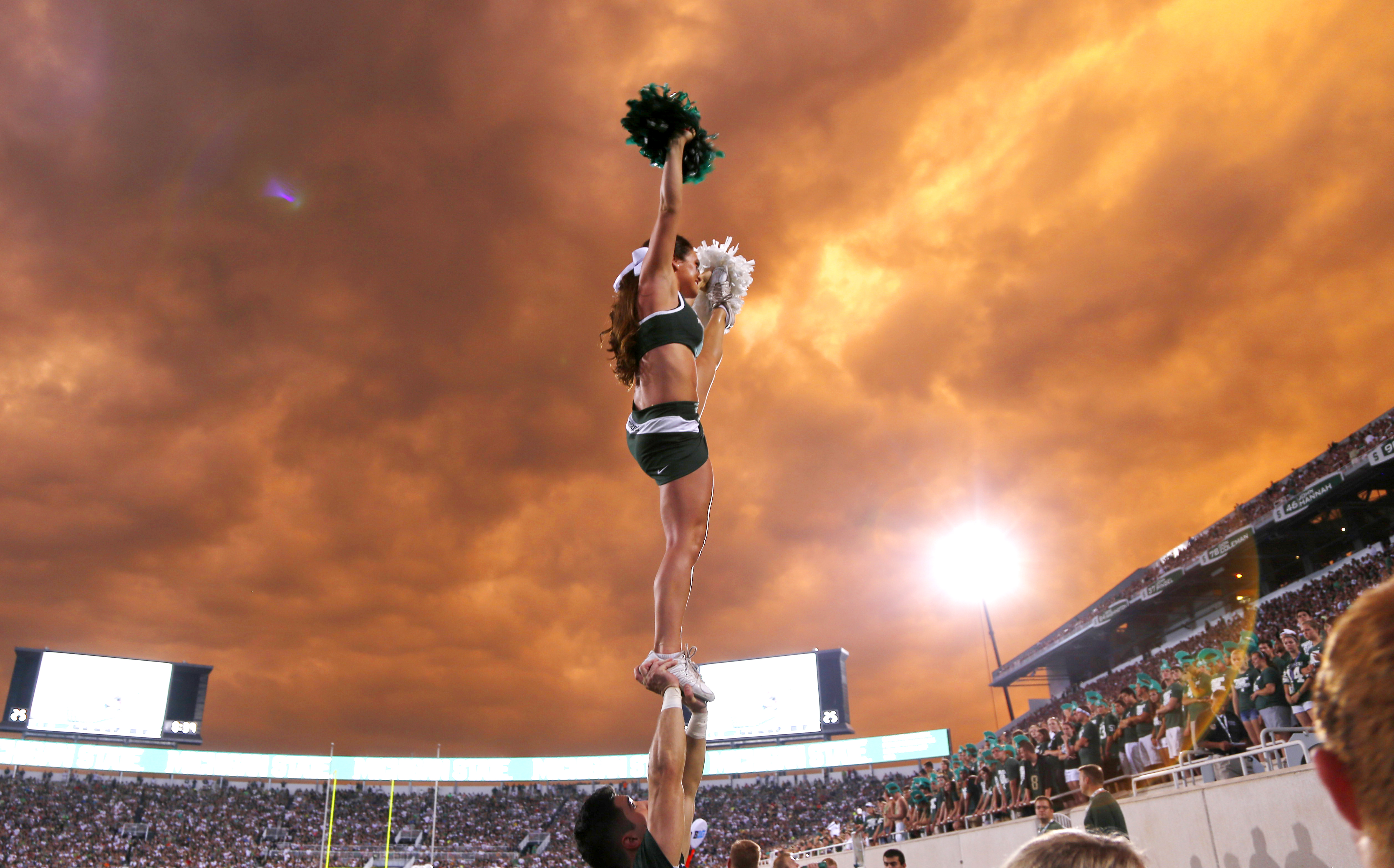 Michigan State cheerleaders perform during the first quarter against Western Michigan in East Lansing, Mich. (AP Photo/Al Goldis)