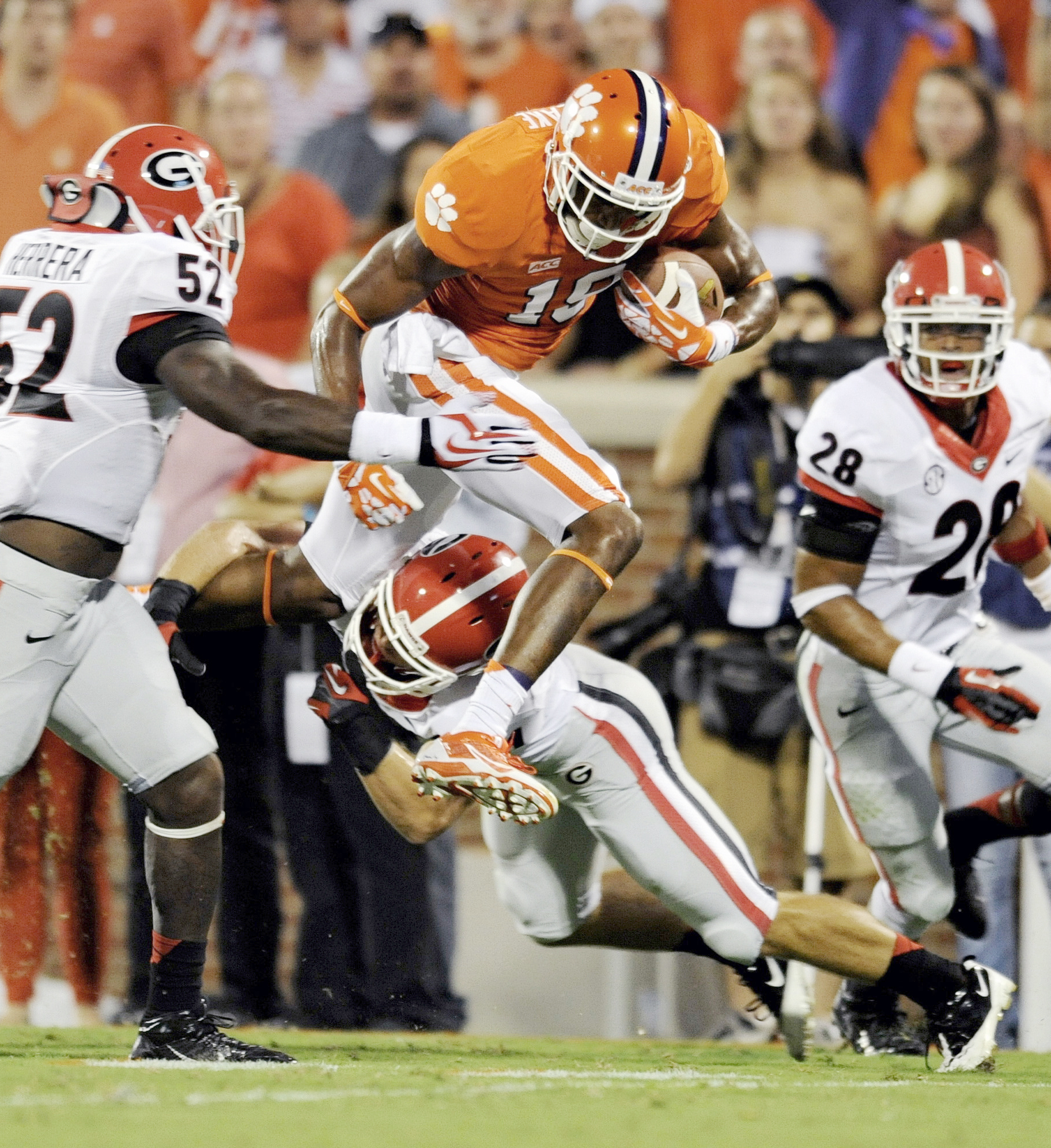 Clemson's Charone Peake leaps through the tackle of Georgia's Connor Norman while being pursued by Amarlo Herrera. (AP Photo/Richard Shiro)