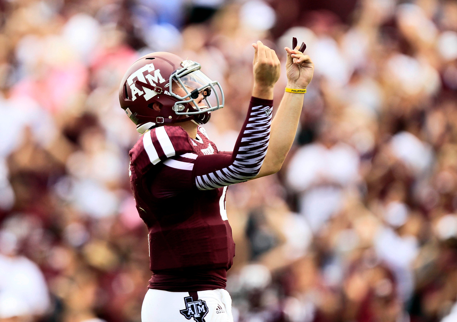 Texas A&M quarterback Johnny Manziel (2) celebrates throwing his first touchdown of the season against during the third quarter at Kyle Field. (Thomas Campbell-USA TODAY Sports)
