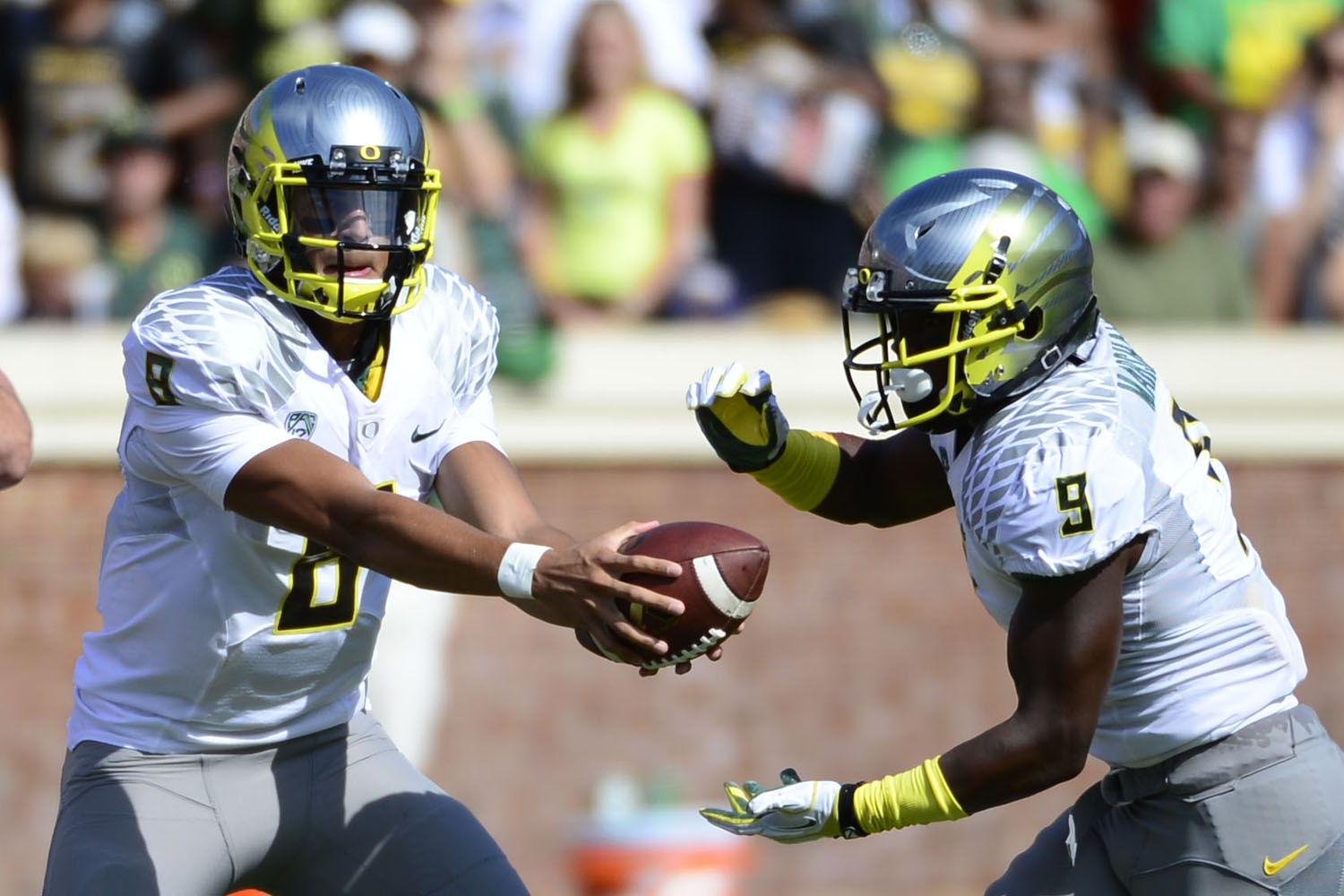 Oregon Ducks quarterback Marcus Mariota (8) hands the ball off to running back Byron Marshall (9) in the first quarter at Scott Stadium. (Bob Donnan/USA TODAY Sports)