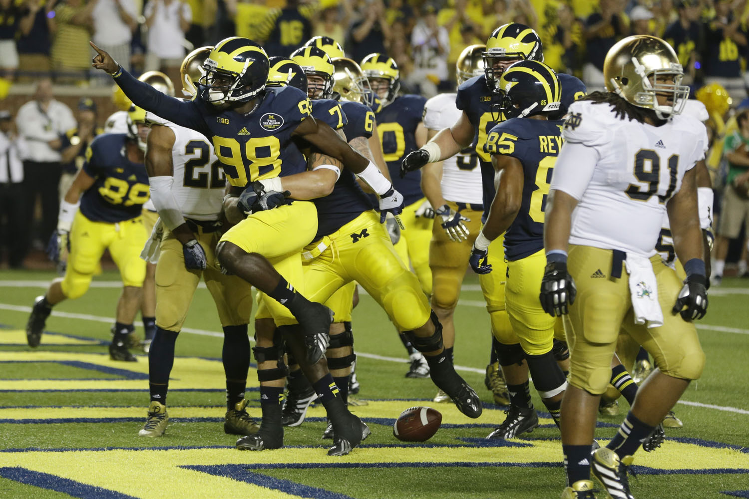 Michigan quarterback Devin Gardner (98) celebrates his touchdown in a 41-30 win over Notre Dame in Ann Arbor, Mich. (AP Photo/Carlos Osorio)