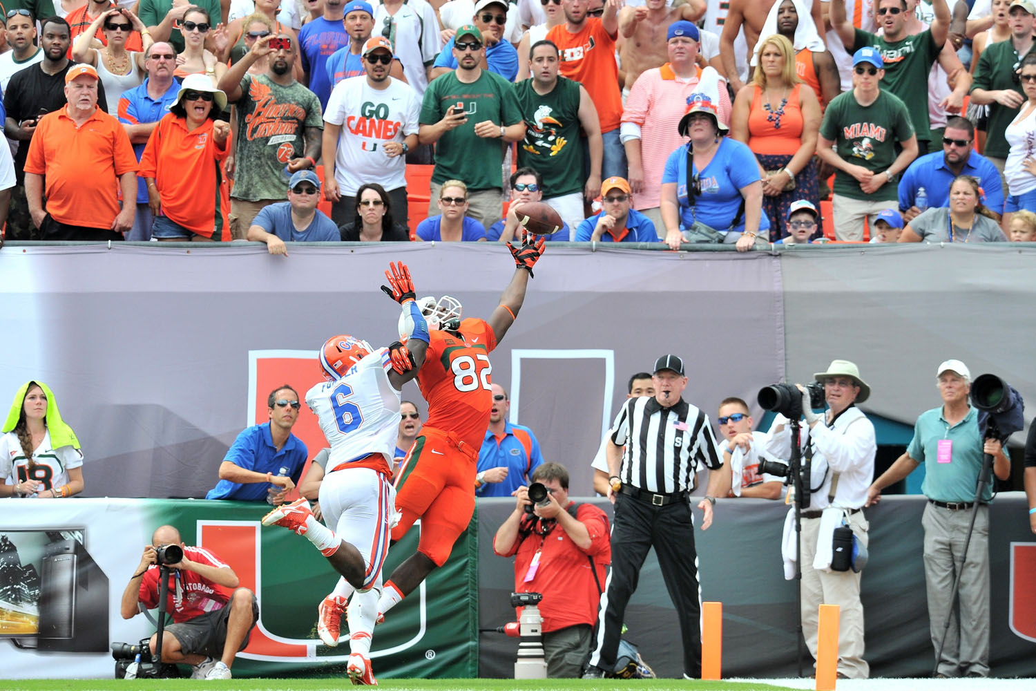 Florida defensive end Dante Fowler Jr. (6) is called for pass interference against Miami tight end Asante Cleveland. (Steve Mitchell/USA TODAY Sports)