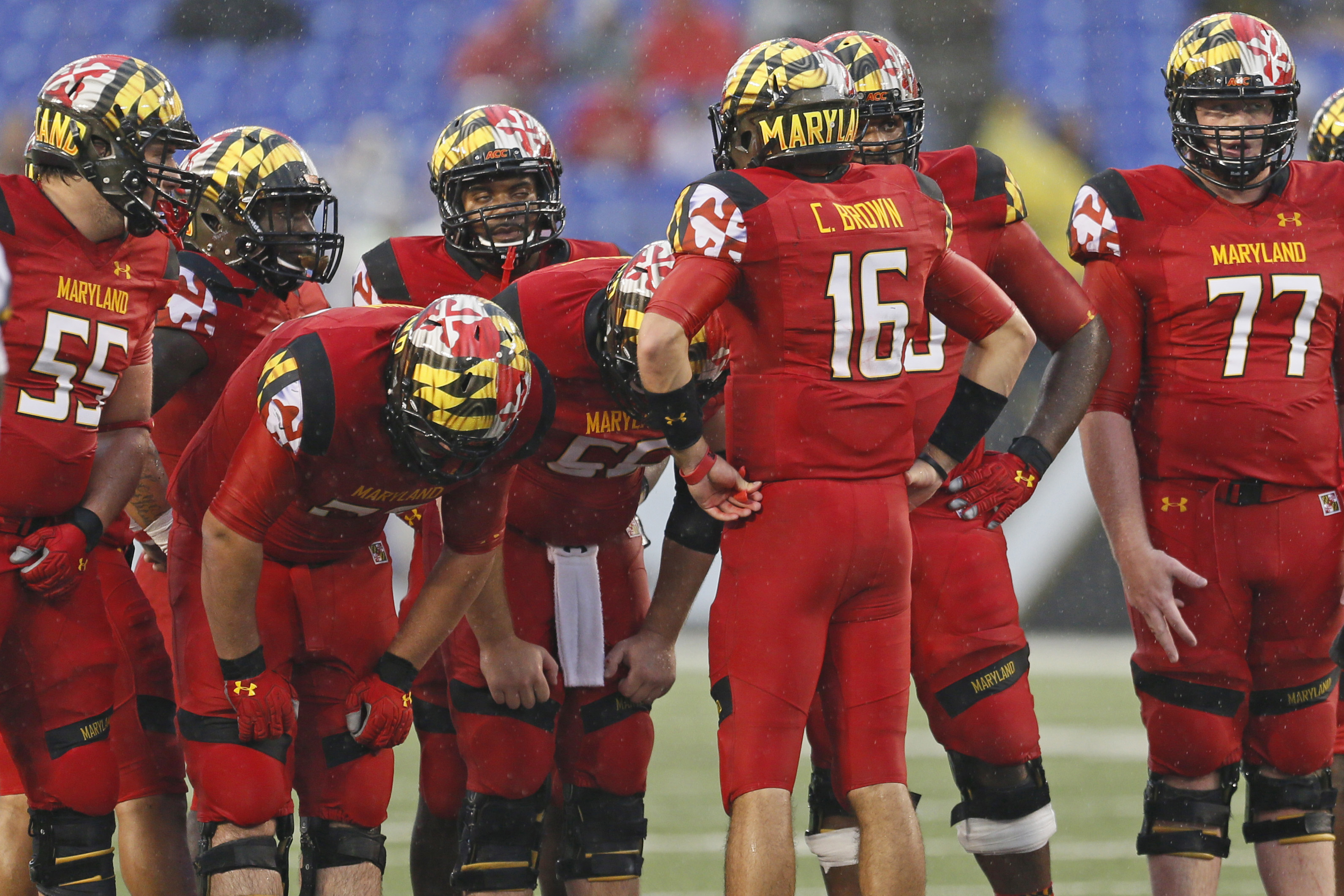 Sep 21, 2013; Baltimore, MD, USA; Maryland Terrapins quarterback CJ Brown (16) leads the offensive huddle during the game against the West Virginia Mountaineers at M&T Bank Stadium. (Mitch Stringer-USA TODAY Sports)